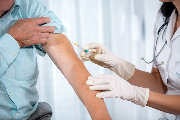 New research shows people who received at least one flu vaccination were less likely to get Alzheimer's disease over the course of a lifetime. (Photo credit: Getty Images)