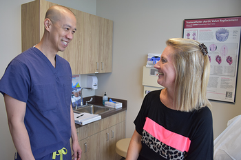 Heart patient Maria Mamaux and her surgeon Tom Nguyen, MD, are both big on the Cypress-Fairbanks-Independent School District. (Photo by Rob Cahill/UTHealth)