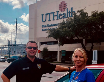 Photo of Andrew Kincannon, paramedic and firefighter, and Jessica Yeager, HEROES recovery coach, head out to knock on doors of opioid overdose survivors. (Photo credit: Andrea Yatsco/UTHealth)