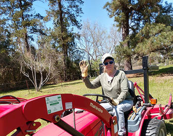 Giselle Doss, replacing barbed wire fencing on her farm. Doss, 67, used to spend her days indoors suffering from chronic diarrhea related to irritable bowel syndrome (IBS), a condition that confined her to her home. (Photo by Giselle Doss)