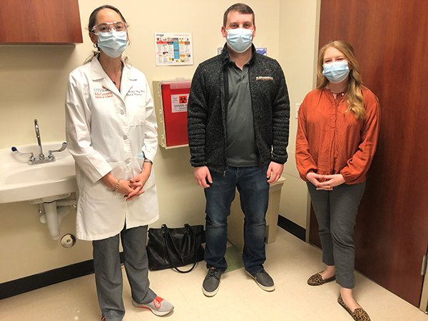 The couple, who enrolled in separate COVID-19 antibody clinical trials at UTHealth, at their day 29 appointments with Netanya S. Utay, MD. (Photo by: UTHealth)