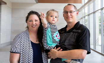 Photo of Alisha Mehaffey with her 2-year-old daughter Scarlett and husband Randall. Photo credit is Maricruz Kwon/UTHealth