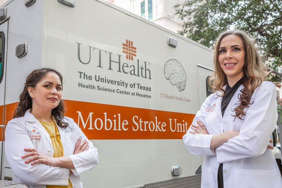 Photo of Amanda L. Jagolino-Cole, MD,  and Alexandra Czap, MD in front of the UTHealth mobile stroke unit. (Photo credit: J. Daniel Escareño/UTHealth)
