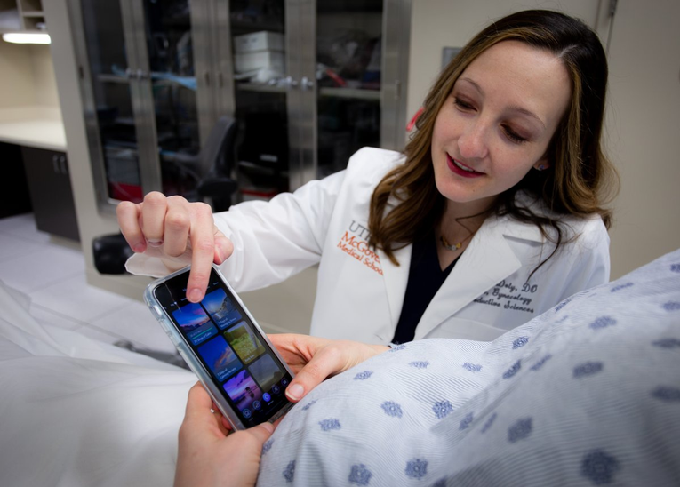 Photo of Morgen Doty, DO, a maternal-fetal medicine fellow at McGovern Medical School, demonstrates how to access mindful meditation programs on the free app. (Photo by Maricruz Kwon/UTHealth)