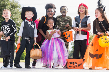 Group of kids in various costumes going trick or treating