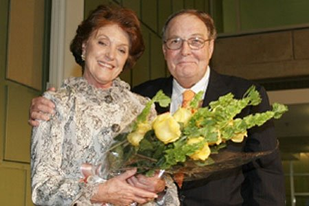 UT-Houston President James T. Willerson, M.D., presents Irma Gigli, M.D., deputy director of The Brown Foundation IMM, with two dozen yellow roses during the Nov. 1 reception for campaign donors.