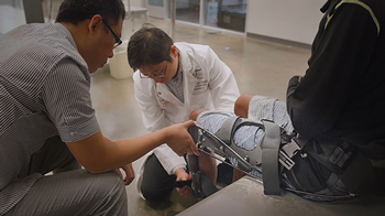 UTHealth's Shuo-Hsiu (James) Chang, PT, PhD, center, and CCNY's Hao Su, PhD, are testing a mobility device for seniors.