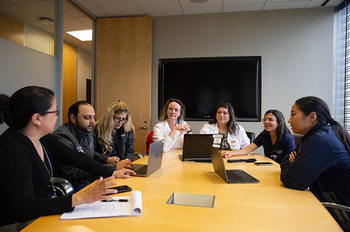 Photo of the surgeons in the Comprehensive Congenital Colorectal Program at UTHealth meeting together as a group to discuss a patient and decide on a treatment plan. (Photo by Rogelio Castro/UTHealth)