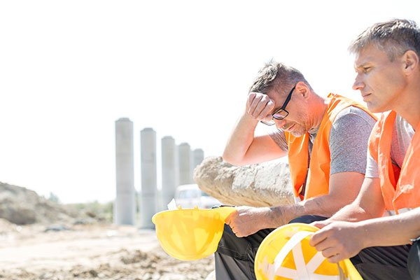 Photo of outdoor construction workers in the heat. (Photo credit: Getty Images)