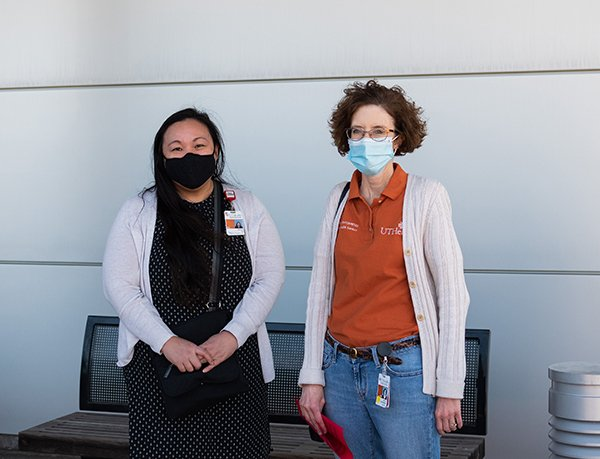 Photo of Le and Volek-Smith who were on-site to ensure the drive-thru vaccination effort was a great experience for patients. (Photo by Kim Kham, UT Physicians)