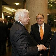 Eugene Vaughn, vice chairman of the UT-Houston Development Board (left), speaks with Chancellor Mark G. Yudof (right), as Dr. Willerson looks on. The three were celebrating the Nov. 1 official dedication of the Fayez S. Sarofim Research Building.