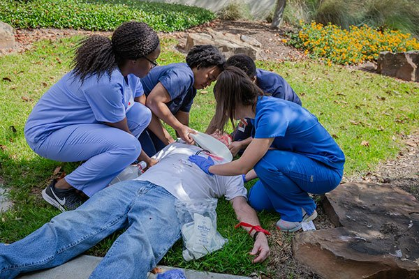 Photo of UTHealth students respond to crisis during a mass casualty drill. (Photo by: Daniel Escareno)