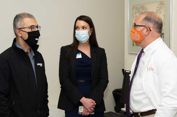 Announcing their new partnership are, from left, Esmaeil Porsa, MD, Glorimar Medina, MD, and John Valenza, DDS. (Photo credit: Brian Schupp)