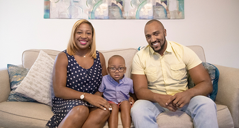 Jasmine and Andre Hicks with their son, Wesley.