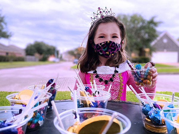 Placing candy in cups for children to pick up instead of handing out candy can help with social distancing rules. (Photo by Lauren Mathews/UTHealth)
