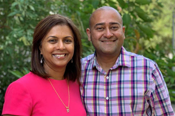 Photo of Shreela Sharma and husband Vibhu Sharma. Both are smiling, pictured with greenery behind them. (Photo credit: Rachael Atterstrom/UTHealth)