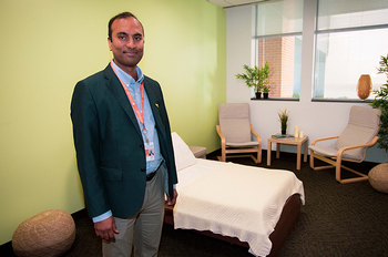 Sudhakar Selvaraj, MD, PhD, stands in a specially designed, home-like, treatment room that will be used for the trial.