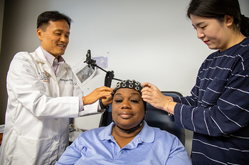 "Researchers at UTHealth are studying the effects of transcranial direct current stimulation (tDCS) or ""brain massage therapy"" for pain management in persons with dementia. (Photo by UTHealth)"