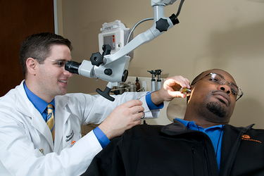 Photo of UTHealth/UT Physicians Ron Karni, MD, and a patient. (Photo by UTHealth)