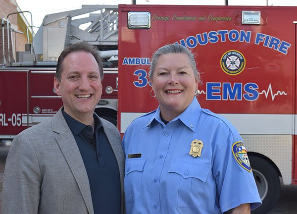 Pictured are UTHealth's James Langabeer, Ph.D., M.B.A., and Houston Fire Department Capt. Karen DuPont. PHOTO CREDIT Rob Cahill, UTHealth