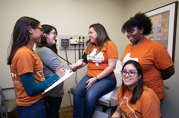 Photo of UTHeallth student volunteers,  from left, are Sonia Patel, Mary Esmeralda Fuentes, Brittany Jewell, Erika Flores, and Josephine Darpolor. (Photo by Maricruz Kwon/UTHealth)