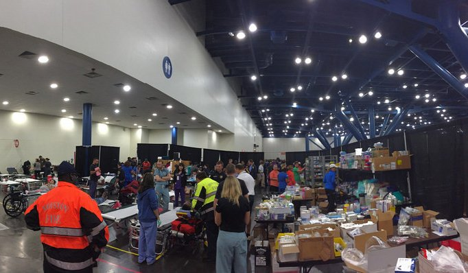 Photo of Hurricane Harvey service care providers prepare for evacuees at the George R. Brown Convention Center. PHOTO CREDIT: Courtesy of Kamal Busaidy, D.D.S.