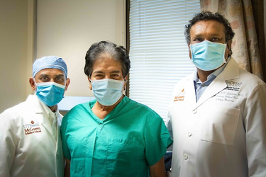 Photo of Manish Patel, MD, (left) and Soma Jyothula, MD, (right) who were part of a UTHealth team that came together for double-lung transplant COVID-19 patient, Francisco Medellin (center). (Photo by Maricruz Kwon/UTHealth)