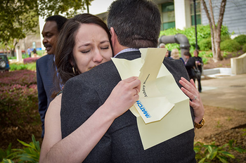 Ashley Romo hugs her father David after learning she and her fiancé Omare Okotie-Eboh both matched to residencies in Houston.