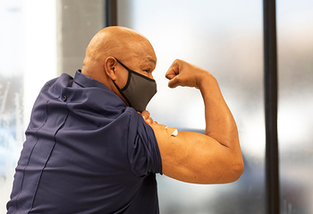 Community advocate and boxing legend George Foreman encourages others to take the COVID-19 vaccine. (Photo by Cody Duty, UTHealth)