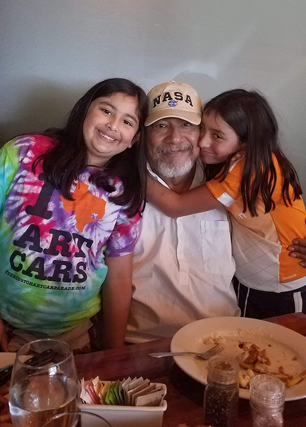 Sandoval pictured with two of his five granddaughters. (Photo credit: Monica Sandoval)