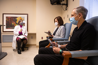 Carmel B. Dyer, MD, speaks to two trial participants at the UTHealth Clinical Research Unit at Memorial Hermann-Texas Medical Center. (Photo by: Roger Castro/UTHealth)