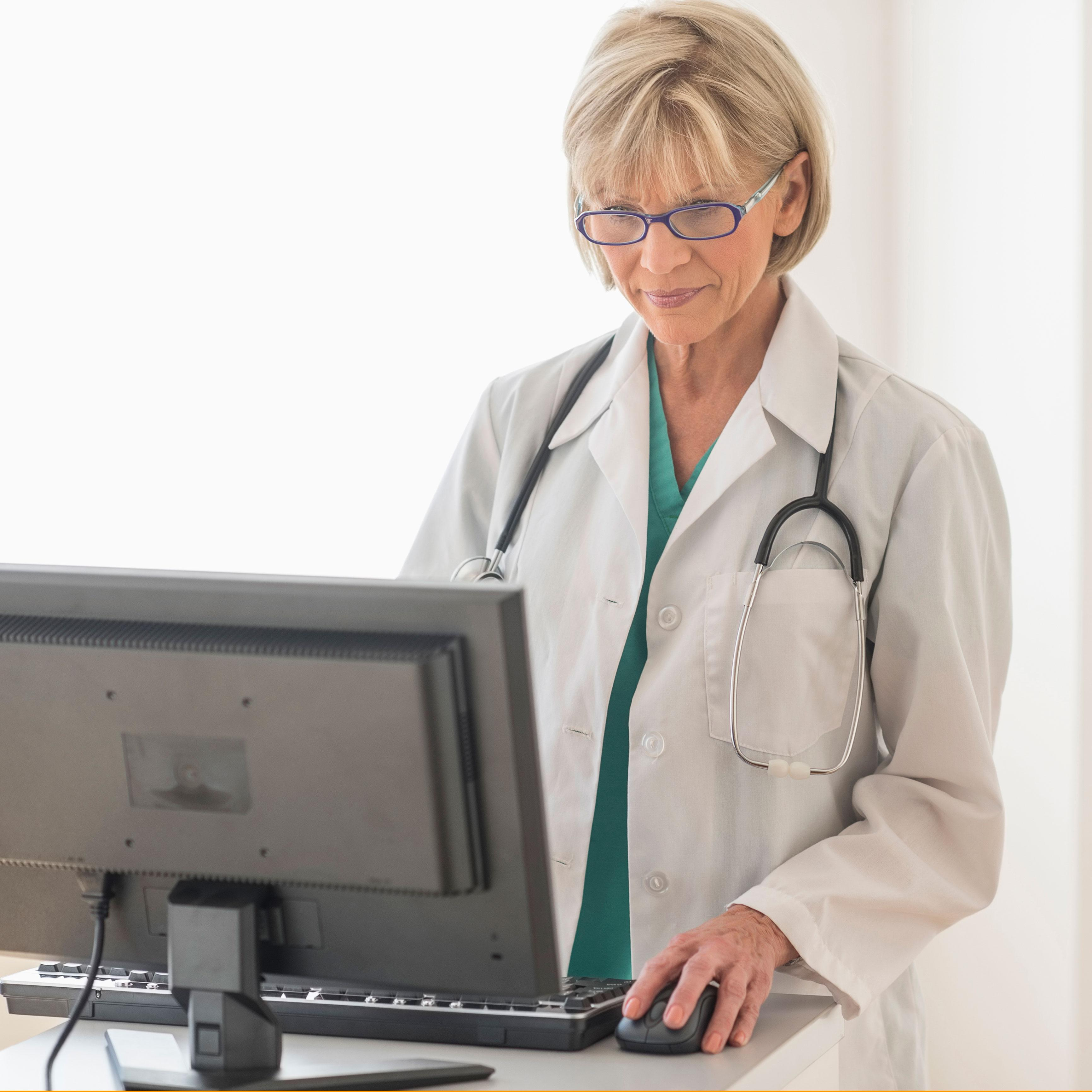 Image of a female clinician using a computer in a clinic