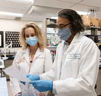 Photo of Tatiana Barichello, PhD and Rodrigo Morales, PhD. They are researching the role of peripheral and brain infections in the development of Alzheimer's disease with a grant from the National Institutes of Health. (Photo by Rogelio Castro/UTHealth)
