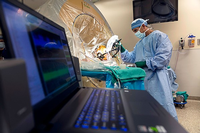 Photo of Albert Fenoy, MD, performing deep brain stimulation surgery (DBS) at Memorial Hermann-Texas Medical Center. He is now leading a new research study on DBS. (Photo by Memorial Hermann)