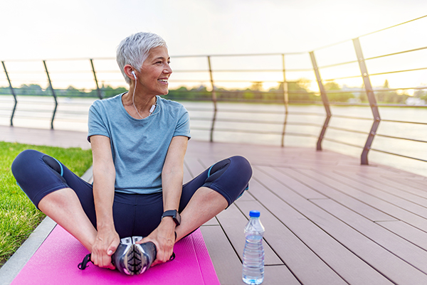 Photo of woman doing yoga. This Phase II study's goal is to determine the safest and most effective number of stem cell doses to slow Parkinson's disease symptom progression so patients can continue their active lives. (Photo courtesy of Getty Images)