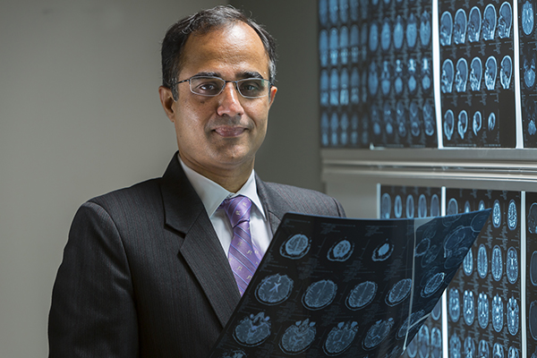 Nitin Tandon, MD, and his research team identified a crucial region in the temporal lobe which appears to act as the brain's visual dictionary. (Photo by James LaCombe)