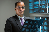 Photo of Nitin Tandon, MD, who identified a crucial region in the temporal lobe which appears to act as the brain's visual dictionary. (Photo by James LaCombe)