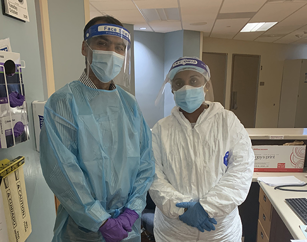 Lokesh Shahani, MD, and Roshan Cherian, RN, wear PPE to work in a special COVID-19 unit at UTHealth Harris County Psychiatric Center. (Photo by UTHealth)
