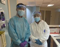 Photo of Doctor Lokesh Shahani and nurse Roshan Cherian wearing PPE to work in a special COVID-19 unit  at UTHealth Harris County Psychiatric Center. Photo by UTHealth.