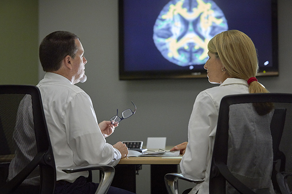Scott Lane, PhD, and Joy Schmitz, PhD, of the Faillace Department of Psychiatry and Behavioral Sciences at UTHealth, discuss their joint research on addiction. (Photo by Terry Vine Photography)