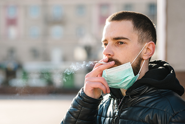 Photo of man smoking.