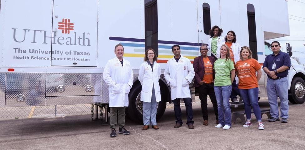 The research team pictured with the mobile unit.