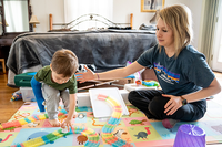 Therapist Kelsey Burke of the Fralin Biomedical Research Institute Neuromotor Research Clinic works with a young patient using I-ACQUIRE therapy. (Photo by: Fralin Biomedical Research Institute)