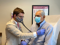 Gustavo Oderich, MD, FACS, checks Rodolfo Sandoval's heartbeat at his six-week post operation checkup. Oderich repaired Sandoval's complex aortic aneurysm with a minimally invasive procedure. (Photo by: Caliann Ferguson/UTHealth)
