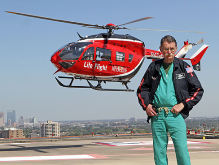 Dr. Duke standing in front of the life flight helicopter