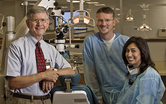 A UTHealth dental professor with students